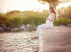 Lemonade Stand Photography maternity photography pregnant woman sitting on the dock wearing a white dress