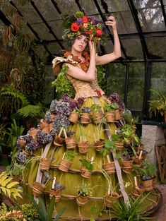 """Mobile Garden Dress"" by Canadian artist, Nicole Dextras. This dress is a self-sustaining garden and flexible shelter, complete with pots of edible plants and a hoop skirt which converts into a tent at night. A finalist in the Repurposed Materials and Design division."