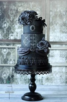Gothic wedding cake filled with milk chocolate ganache and crunchy chocolate slices