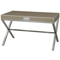 """Uttermost Lexia Modern Desk in Bronze Mirror 24298. Material: Glass, Mdf, Metal & Wood. Bronze mirror-faceted desk with generous wide drawer. Chrome Bar Pull Over beveled white mirror plate. Stainless Steel Stretcher Base - Minor assembly is required. Dimensions: 52"""" L x 24"""" W x 30.25 """" H - Box weight: 95 LB."""