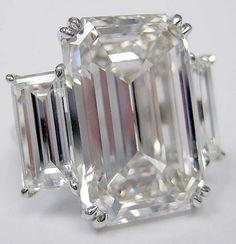 Hot Pick of the Day: Huge Diamond Ring featuring 18ct Emerald Cut Centerstone! « J.R.Dunn's Jewelry Blog  if my future man knows me, he would know my style isa edgy...and he would get me an emerald cut ring. or something with cool angles. no princess, no round, nothing too girly lol