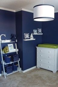 lime and navy nursery. don't know if I could ever paint the walls that dark, but it looks cool