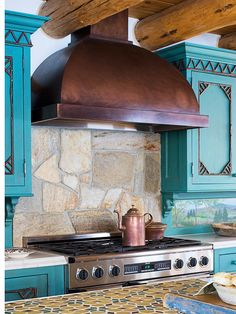 This backsplash is unusual and beautiful, but, once again, I question the practicality. I ADORE  the range hood, though, and the cabinet color.