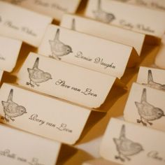 Cute little birds and aged paper gave the escort cards a rustic look and feel.