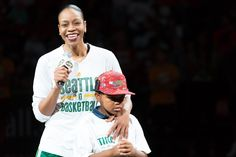 Tina holds son Dyllan close as she addresses the 8,900+ in attendace at her final WNBA regular-season game. Photo credit: Neil Enns/StormBasketball.
