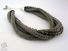 Elegant Spool Knitting Jewelry - no directions,  just inspiration - the blog is in Italian.  There appears to be several posts on many different jewelry items made with spool knitting.