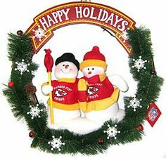 """Kansas City Chiefs 20"""" Team Snowman Wreath by Caseys. $39.95. This team snowman Christmas wreath is accented with pine cones, holly berries and two snowmen dressed in official NFL team colors with an authentic logo. The wreath is 20 inches in size. Perfect for your holiday home décor, or to give as a gift to your favorite sports fan!. SC Sports NFL Holiday Wreaths. This team snowman Christmas wreath is accented with pine cones, holly berries and two snowmen dressed in offic..."""