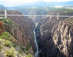 Royal Gorge Bridge. Too scary to ride across, so we took helicopter tour over, turned out to be MUCH scarier when he flew nose first down into the canyon!