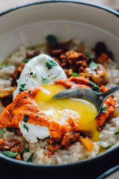Savory Spanish Oatmeal Bowls topped with chorizo, a poached egg, and tangy romesco sauce  Calories: 415