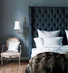 Headboard for bedroom, but in emerald green velvet. Also with dark charcoal walls and white bedding.