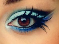 blue eye makeup with fake eyelashes. beautiful