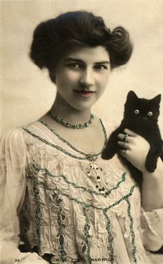 Woman with black kitten (real photo postcard)