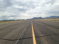 Standing on an active runway at the Avra Valley (Marana) Airport in August 2014. I have had the worst luck being a passenger in small aircraft. This one crashed on landing due to a landing gear malfunction, and so I took the rare opportunity of a snapshot of what it's like to stand in the middle of a runway while we waited for the aircraft (and ourselves) to be towed back to the hangars. Photo property of Angela D'Onofrio.