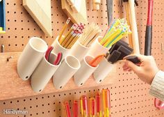 Storage Pockets for Skinny Things Saw off short pieces of 1-1/2-, 2- or 3-in. PVC plumbing pipe with 45-degree angles on one end. Screw them to a board to hold paint brushes, pencils, stir sticks and just about any other narrow paraphernalia in your shop. Mount them by drilling a 1/4-in. hole in the angled end, and then drive a 1-5/8-in. drywall screw through the hole into the board.