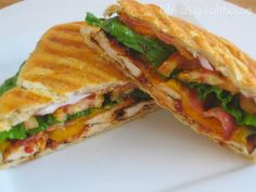 BBQ CHICKEN PANINI Recipe Lunch and Snacks with ciabatta bread, grilled chicken breasts, barbecue sauce, bacon slices, sharp cheddar cheese, romaine lettuce, tomatoes, purple onion