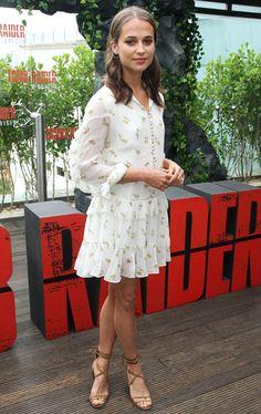 Alicia Vikander in a white ruffle mini dress