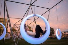 Right next to the Boston Convention and Exhibition Center There are 20 of these extraordinary light up oval swings,