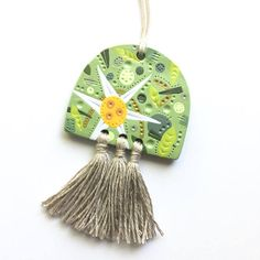 WEIRDLINGS polymer clay pendant with tassels flannel flower