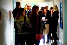 Guests mingle after the opening ceremonly and admire the Art Exhibition of clients' work. http://www.headway-cambs.org.uk/