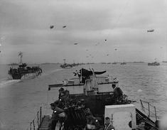 RCN photographer Gib Milne takes this photo from the bridge of LCI 306, looking over the bow at the other LCI headed towards Normandy.