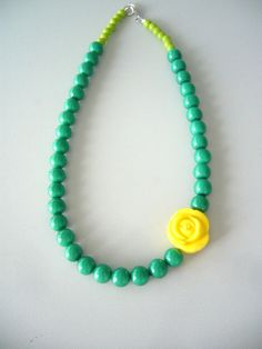 Green necklace with yellow rose