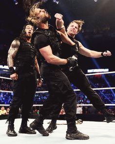 Dean Ambrose punching Seth Rollins during the Shield Summit. [Also... LOL at Roman's face.]