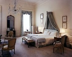 so french...large scale pieces....lots of light and space....ornate accessories