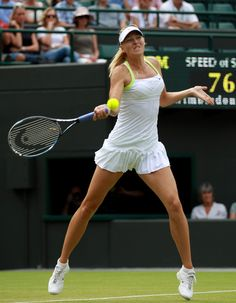 Maria Sharapova Photos - Maria Sharapova of Russia hits a forehand return during her Ladies' singles second round match against Tsvetana Pironkova of Bulgaria on day four of the Wimbledon Lawn Tennis Championships at the All England Lawn Tennis and Croquet Club on June 28, 2012 in London, England. - The Championships - Wimbledon 2012: Day Four