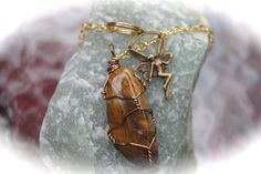 Pendulum Crystal Tigers Eye with a Fairy lob, handmade wire wrapped by GladStonesNSage on Etsy