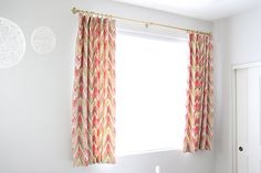 I really like these short curtains with pin hooks. The fabric is cute too. Really well done directions on the DIY.