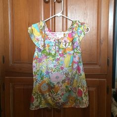 Floral top Pretty floral pattern shell with a ruffle collar has a silky feel; looks great with jeans or dress pants Liberty of London for Target Tops