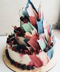 Upstage your dessert table with an artistic touch from this wedding delicacy by @kalabasa! Swooning over the colorful palette in this 3-tiered cake that comes from the berries and spiky chocolate adornment. Pretty, modern, and out-of-the-box! Image via @weddingdream. Who's inspired? Raise your hands!