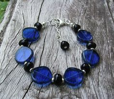 Bold and beautiful - cobalt blue, black, and silver. A bracelet with a lot to say! Bracelet by BonArtsStudio