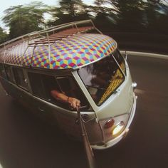 on the fly.... VW Bus with roof rack and awesome geometric roof paint job