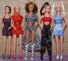 Spice Girls dolls OOOMMGG!!!😮 I had scary spice.. she was, is and will forever be my fav spice girl! GIRL POWER ✌🏿️🙌🏾!! Hehe!