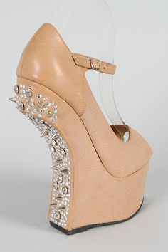 Oh yes! Studded Spike Heeless Wedge. i want one for christmas
