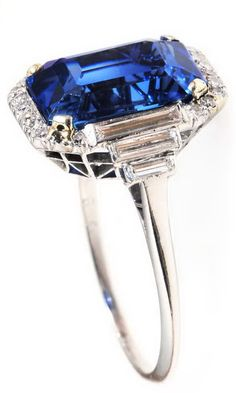 Art deco sapphire and diamond ring. Circa 1920's. English in origin. 6.26 carat central sapphire stone shows no signs of treatment of any kind. The sapphire is flanked by 6 baguette diamonds and surrounded by 18 single cut stones all set in a handmade platinum setting. The stones have been certified by The Gem & Pearl Lab of London, England.
