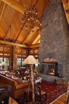 Log cabin great room with massive fireplace.  #rustic #greatroom homechanneltv.com