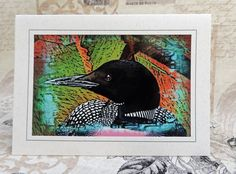 The common Loon is one of the most beautiful birds in nature. With striking red eyes and a haunting call, these water birds have been around for twenty million years. A beautiful card for the bird lover! $5.00.