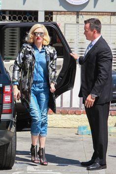 Pin for Later: Gwen Stefani Shows Us the Right Way to Pull Off a Denim Jumpsuit  The booties, the camo jacket, the tortoiseshell glasses — everything was on point.