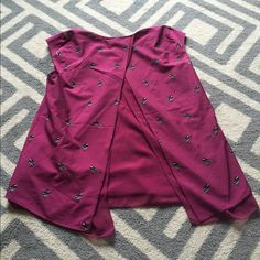 Split-back silky banana republic blouse size small This shirt is beautiful but too wide for my petite frame. Would work well on someone with a larger bust or bigger shoulders. Gorgeous plum color with bird pattern and double layer split back design. NEVER WORN. Only tried on. Perfect condition. Banana Republic Tops Blouses