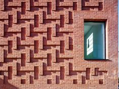 The Green community centre by AOC features herringbone-patterned brickwork - Decor10