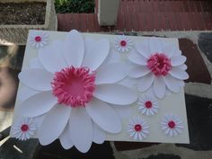 Large Paper Daisy Extra Large Paper Flower Photo Prop Backdrop Nursery Deocr Set of large white paper daisies with pink centers (1) Extra Large white paper daisy , measures 21 (1) Large white paper daisy, measures 12 (6) Small white paper daisies, measures 4 Each flower in an individual item so that you can arrange them as you wish. Great as a centerpiece, wall hanging, photo prop/backdop, the possibilities are endless. For size reference, shown on a 20 by 30 foam co...