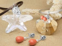Coral Bay Necklace. I like the small dangly pearls with the flat shell...could do similar with that red pearl disc.
