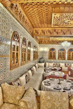 Colours are not for me, nor are the tables, but I love the tiles and the banquettes