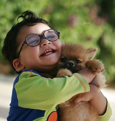 """Who looks happier---kid or dog. Dog looks pretty OK with the whole """"grab me around the neck and squeeze"""" thing."""