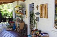 build that back deck space with a gate that locks. boards on racks on wall...