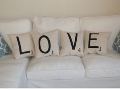 Earn a triple word score by accenting your sofa or bed with these Scrabble tile pillows. Stencil the letters and accompanying number point onto cotton canvas pillowcases with a sponge brush and black fabric paint. Get the tutorial at Limemade Designs...
