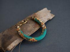 Turquoise+and+gold+beaded+bracelet+ethnic+bracelet+by+Kvalwasser,+$100.00
