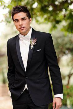 black suit + white bow tie.